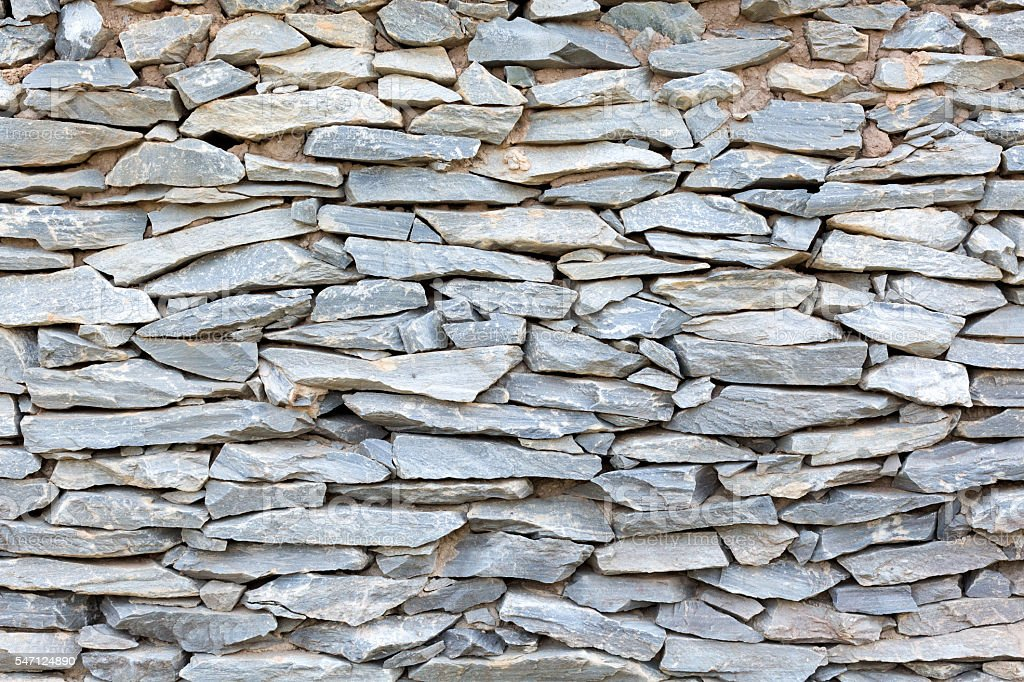 Close up of traditional homemade stone wall stock photo