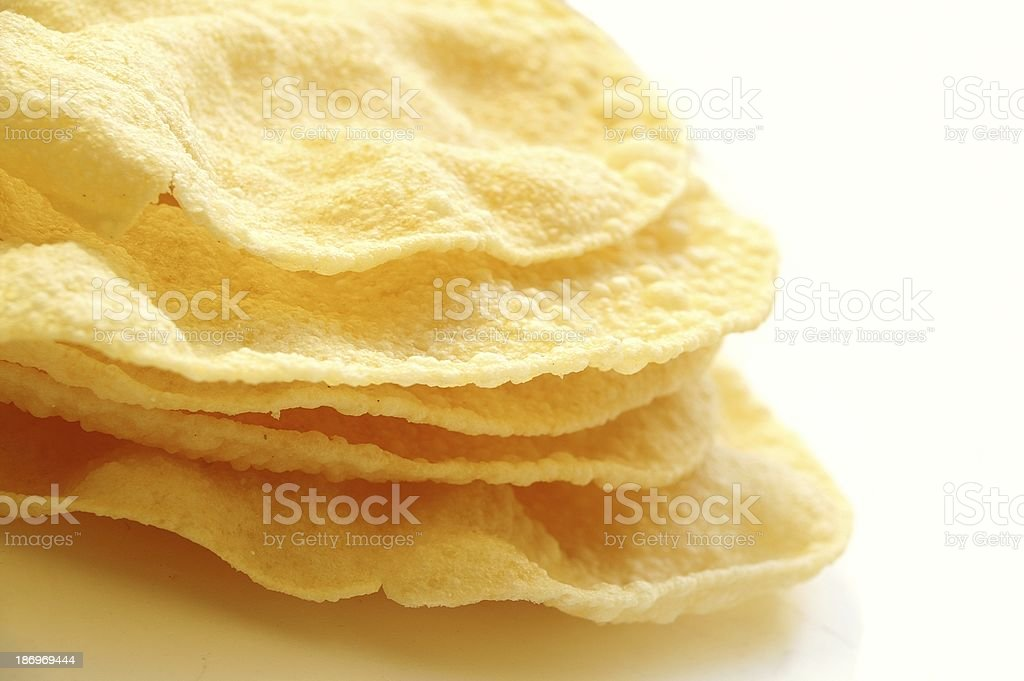 close up of traditional indian Pappadums on white stock photo