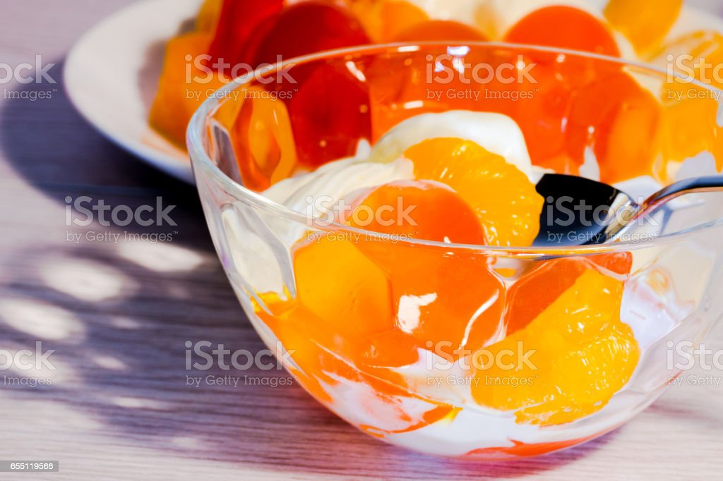Close Up of Translucent Mouthwatering Orange Jelly with Ice Cream stock photo