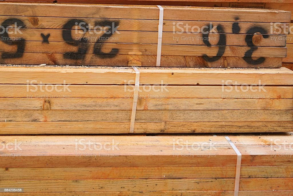 Close Up of Treated Lumber Bundles stock photo