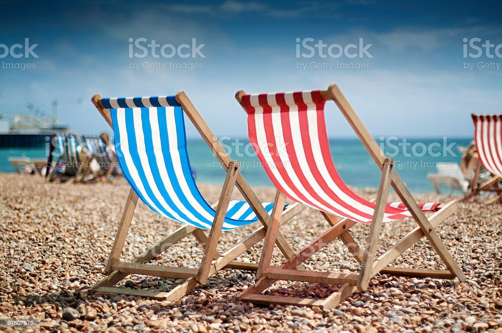 Close up of two deck-chairs on the beach royalty-free stock photo