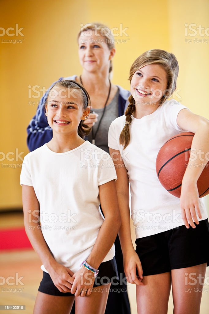 Close up of two girls with basketball royalty-free stock photo