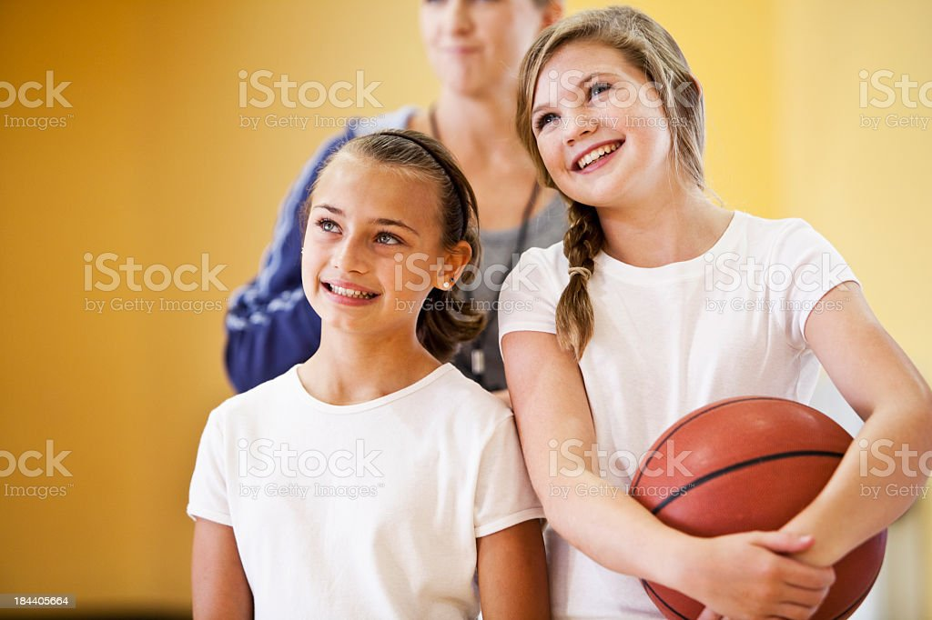 Close up of two girls with basketball stock photo