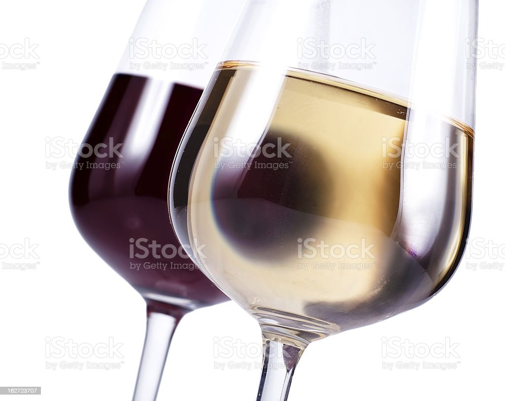 close up of two wineglasses with red and white wine royalty-free stock photo