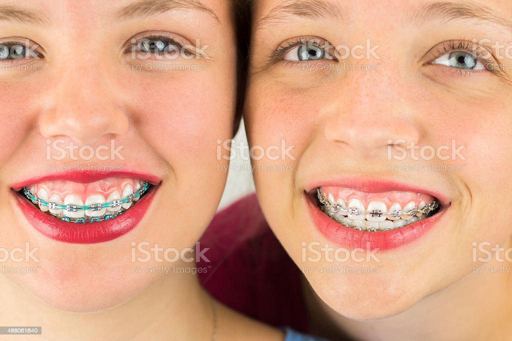 Close up of Two Young Girls Faces stock photo