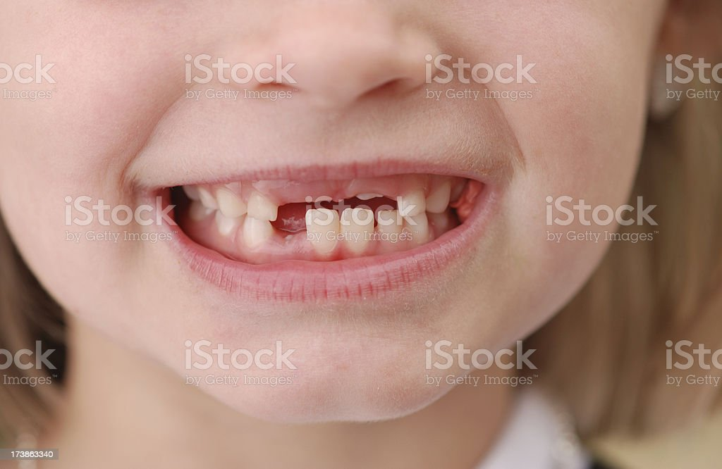 Close up of unrecognizable child smiling stock photo