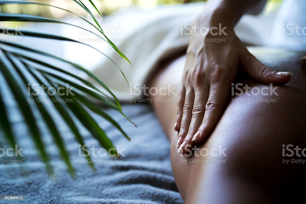 Close up of unrecognizable woman\'s hand massaging a person at the spa.