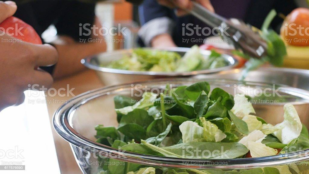 Close up of unrecognizable person preparing salad stock photo