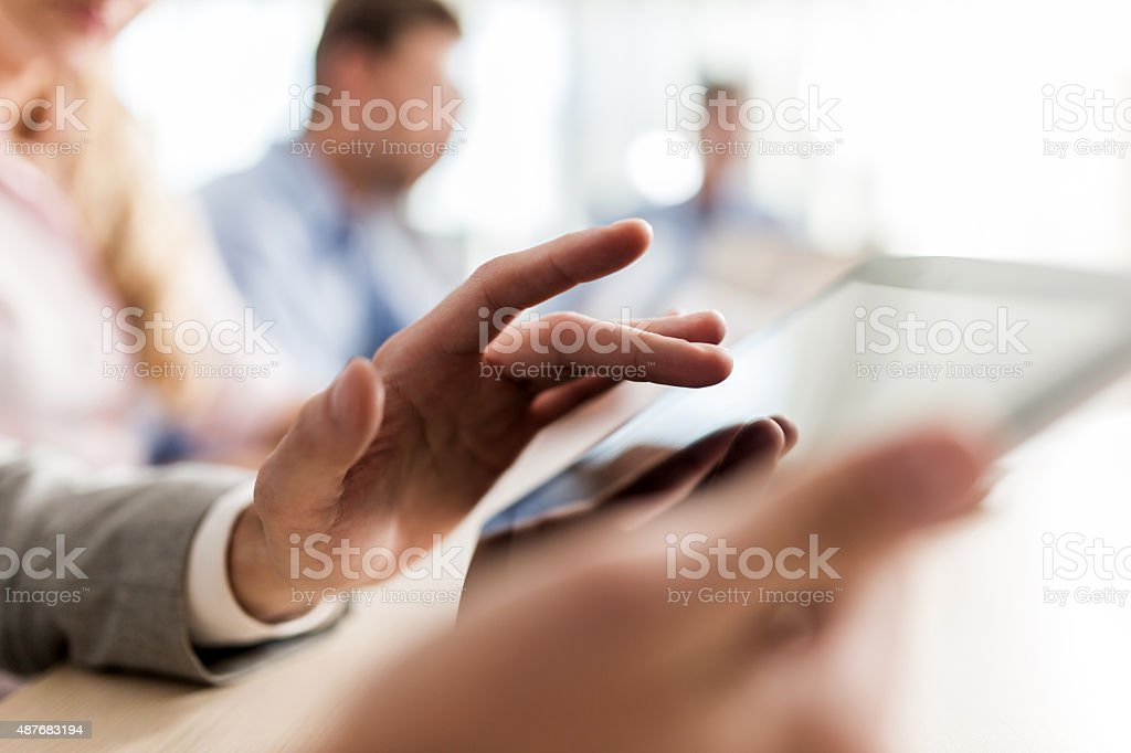 Close up of unrecognizable person using digital tablet. stock photo