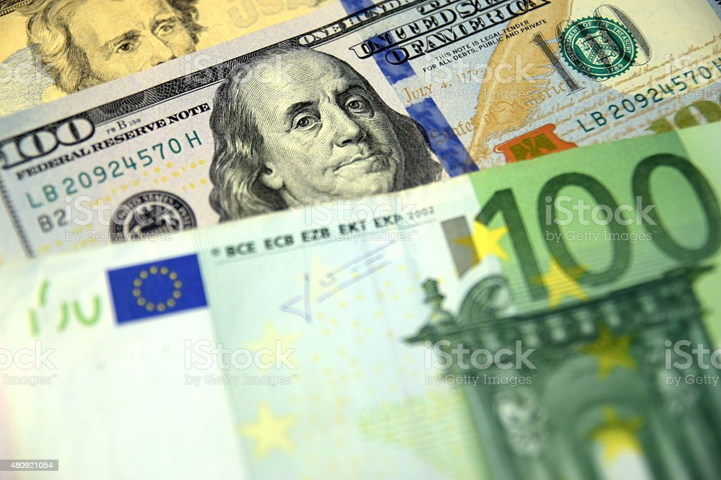 Close up of  Various currency notes and coins, different countries stock photo