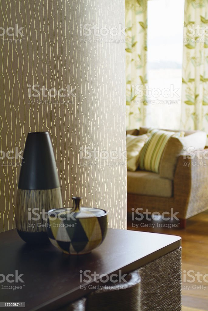 Close up of vases on cabinet against wallpaper royalty-free stock photo
