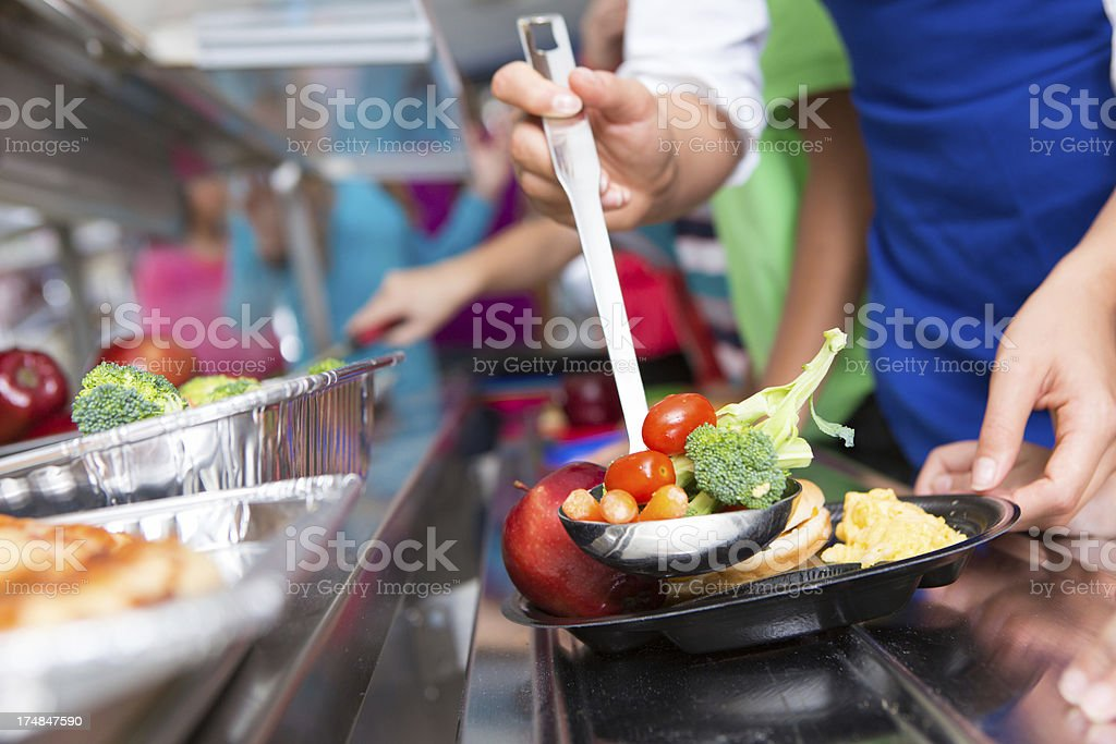 Close up of vegetables; students choosing food in school cafeteria stock photo