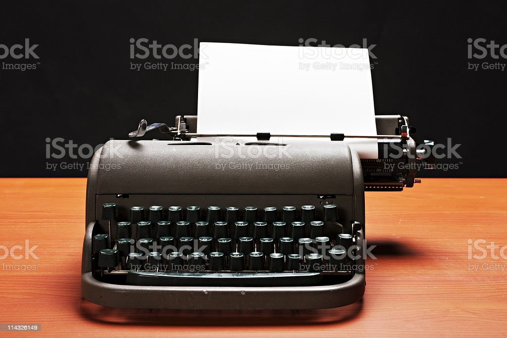 Close up of very old typewriter with blank paper royalty-free stock photo