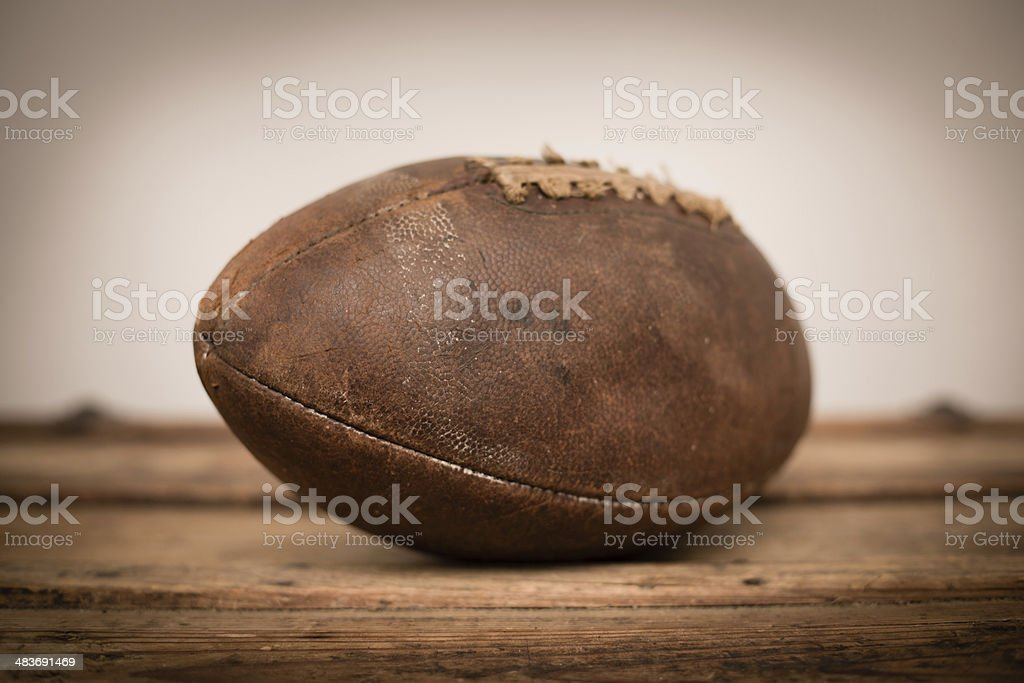 Close Up of Vintage Football Sitting on Old Wood Trunk stock photo