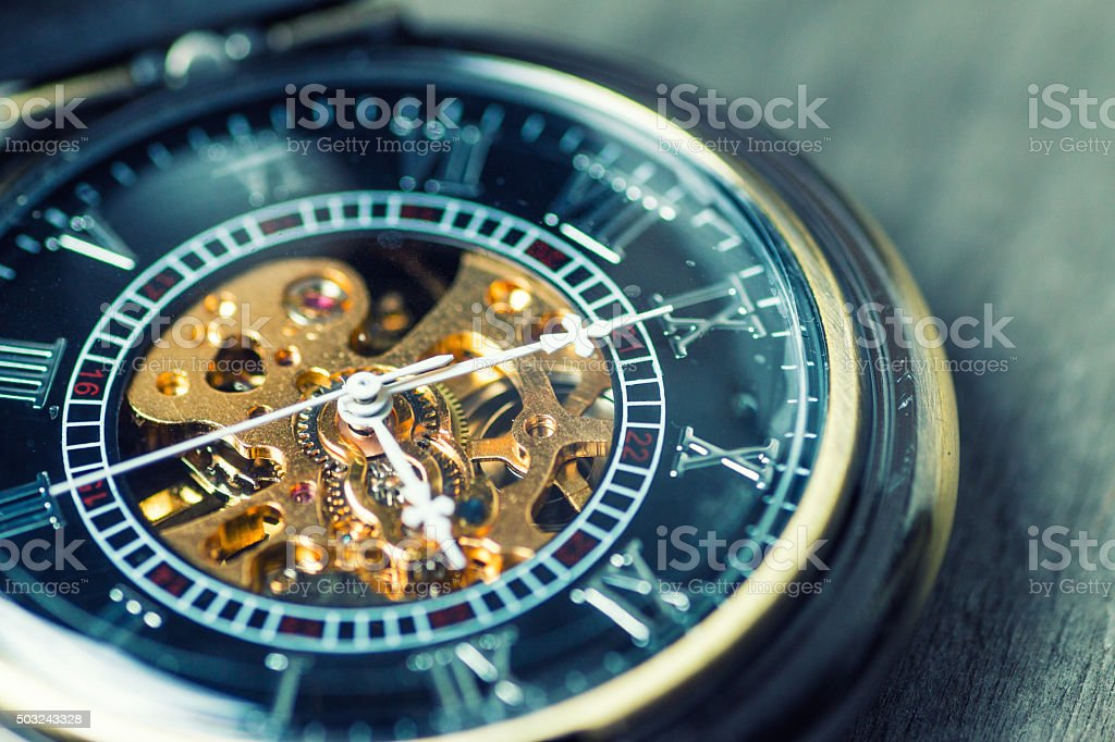 Close up of vintage pocket watch Showing Gears;time concept stock photo