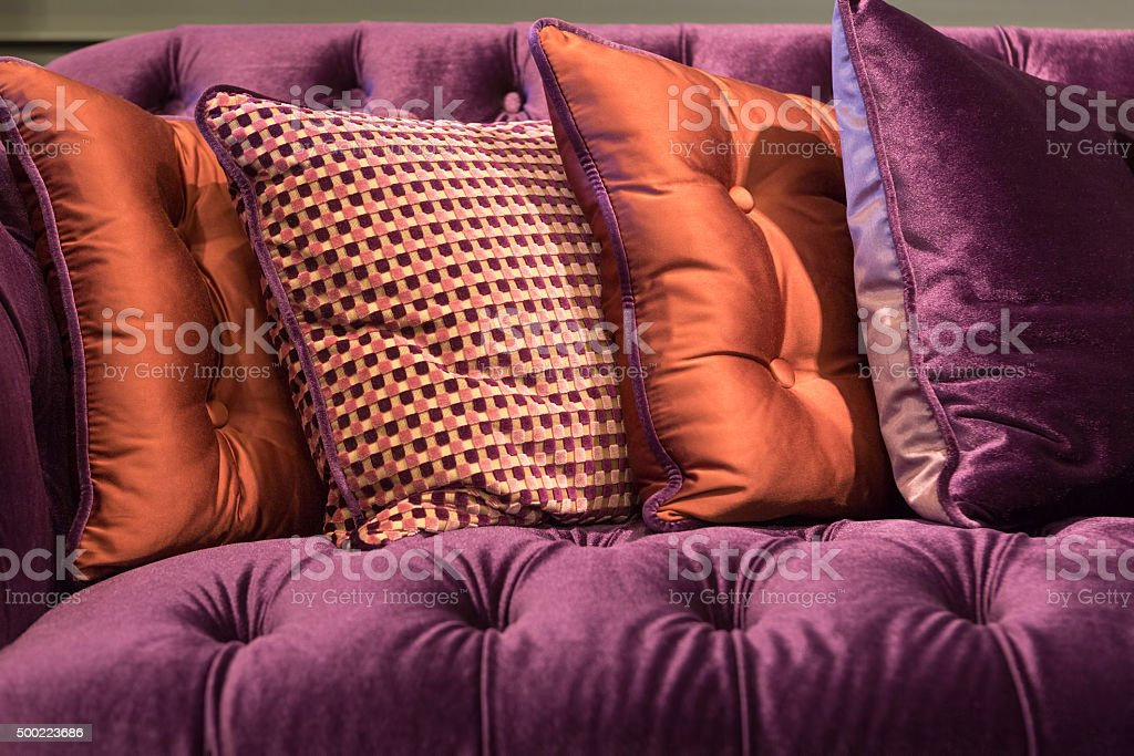 Close up of violet velvet sofa and cushions stock photo