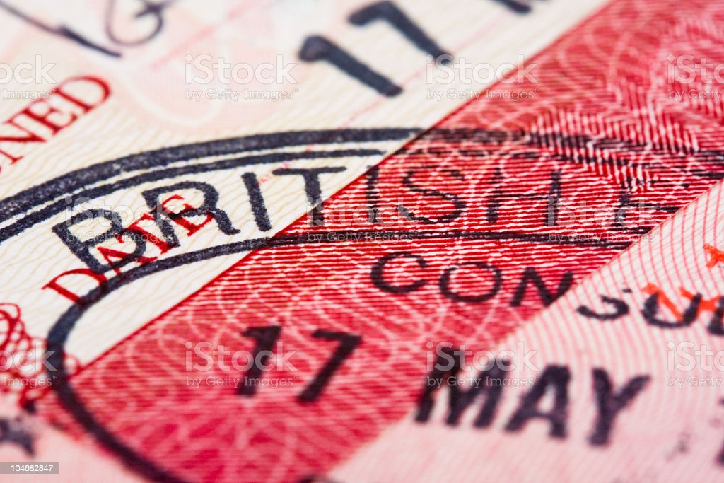 Close up of visa stamp on passport page royalty-free stock photo