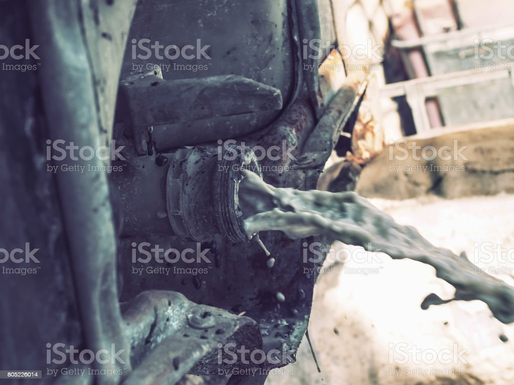 Close up of waste water gushing out of the pipe stock photo