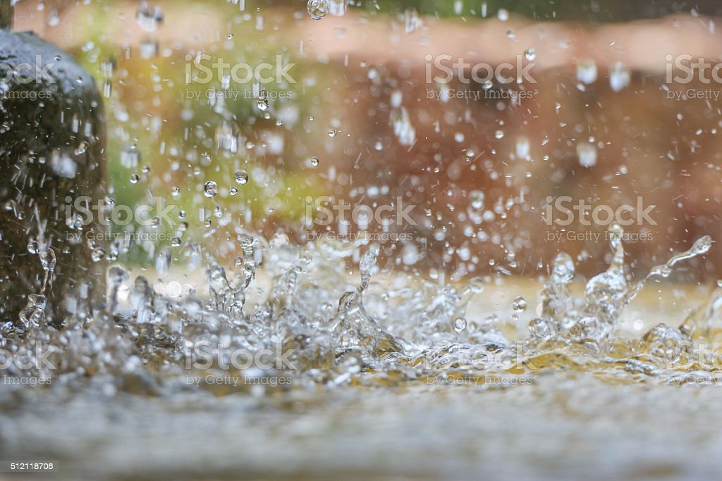 Close up of water drops in the public fountain stock photo