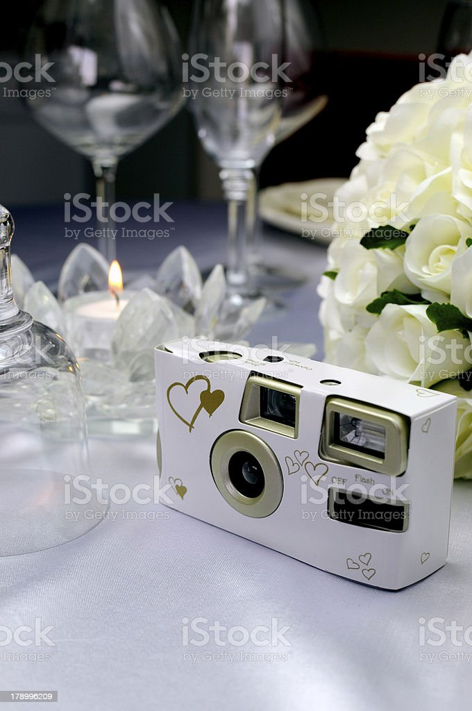 Close up of wedding table setting with disposable camera stock photo
