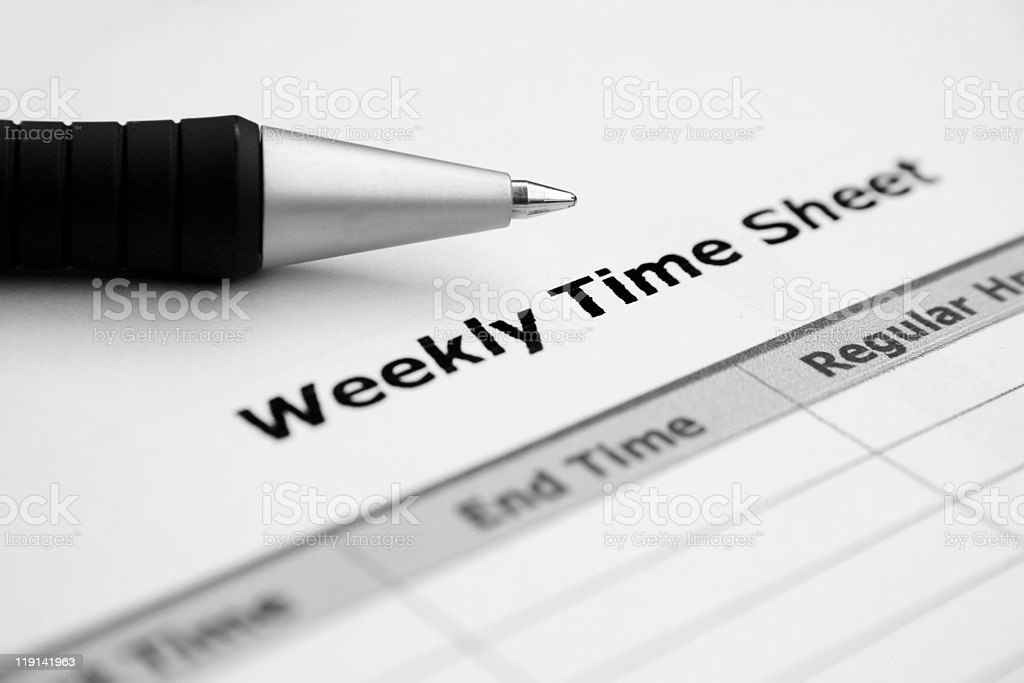 Close up of weekly time sheet with pen stock photo