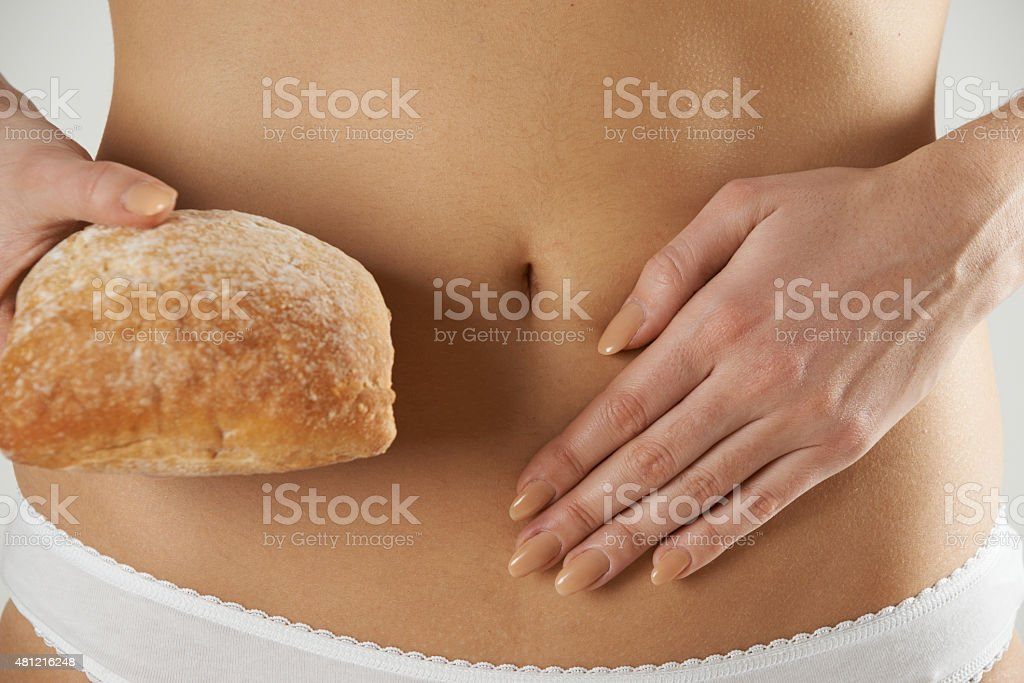 Close Up Of Wheat Intolerant Woman Holding Bread stock photo