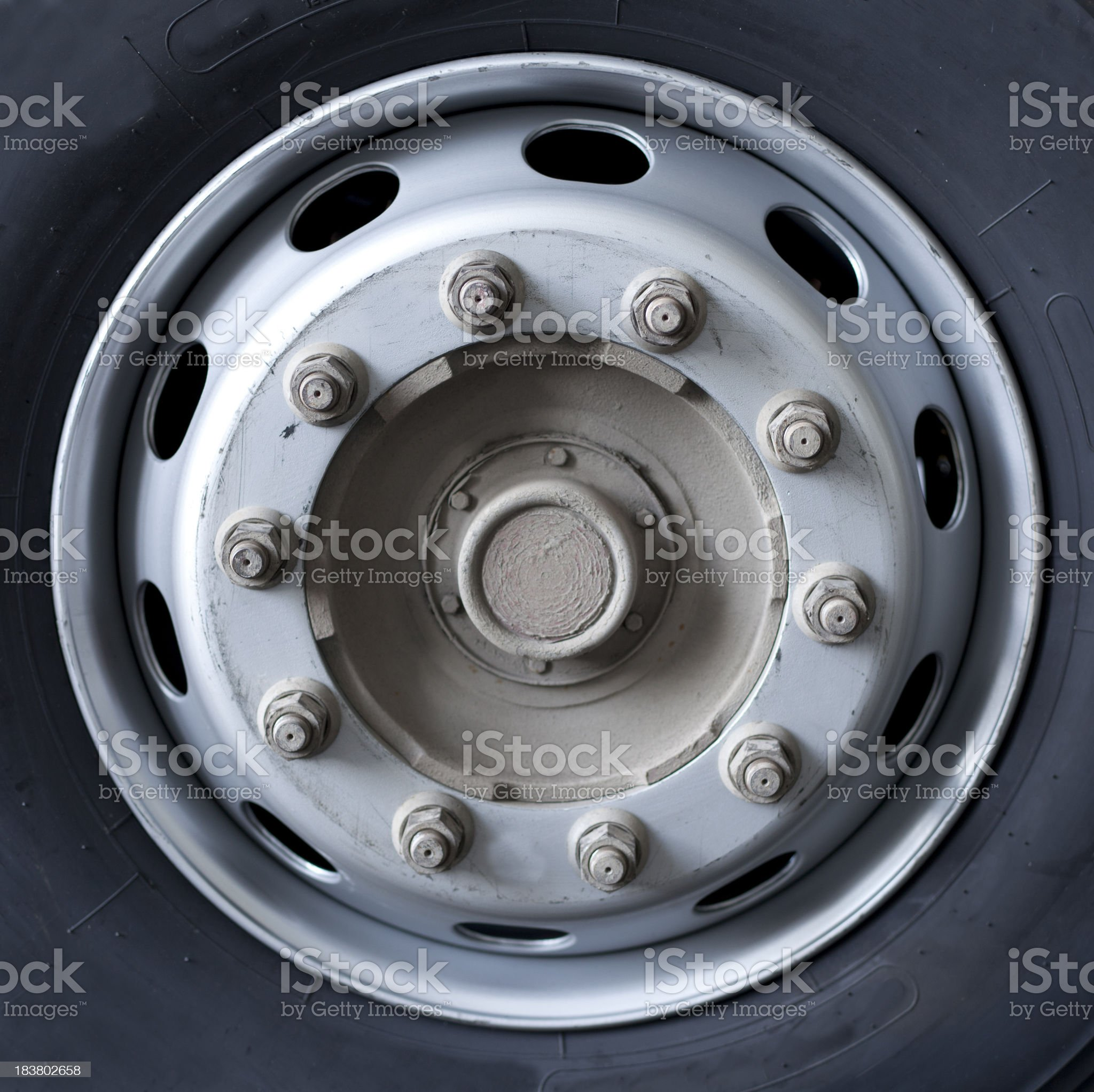 Close up of wheel nuts and rim on a truck royalty-free stock photo