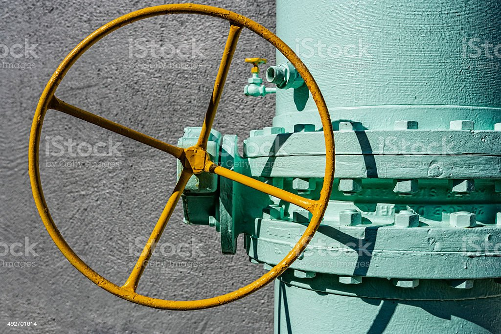 Close Up of Wheel to Shut Off a Large Pipe stock photo