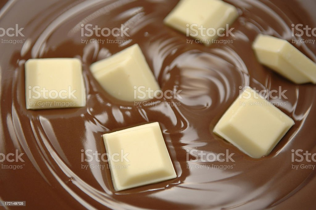 Close up of white chocolate melting in milk chocolate. royalty-free stock photo