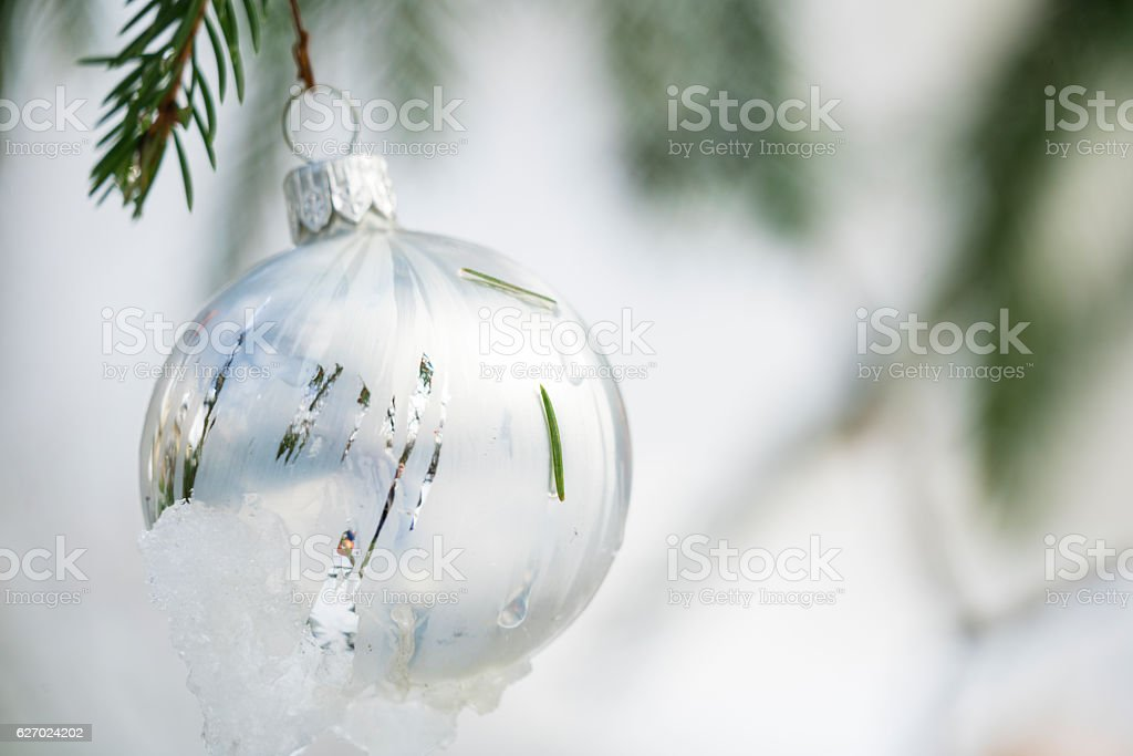 Close up of White Christmast ball with snow stock photo