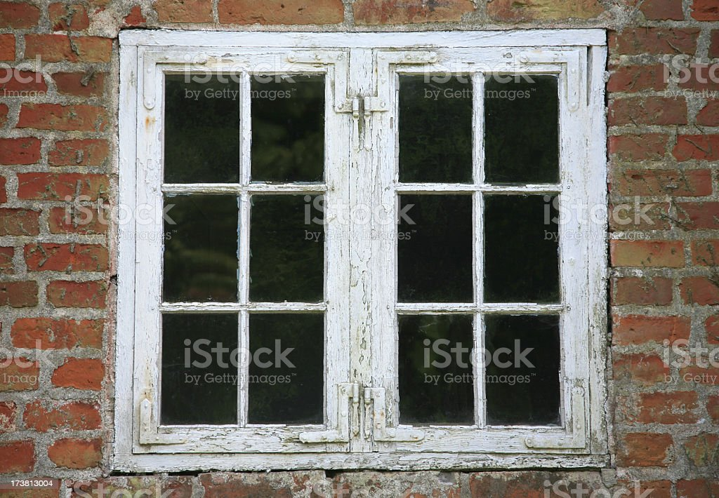 Close up of white framed grungy window stock photo