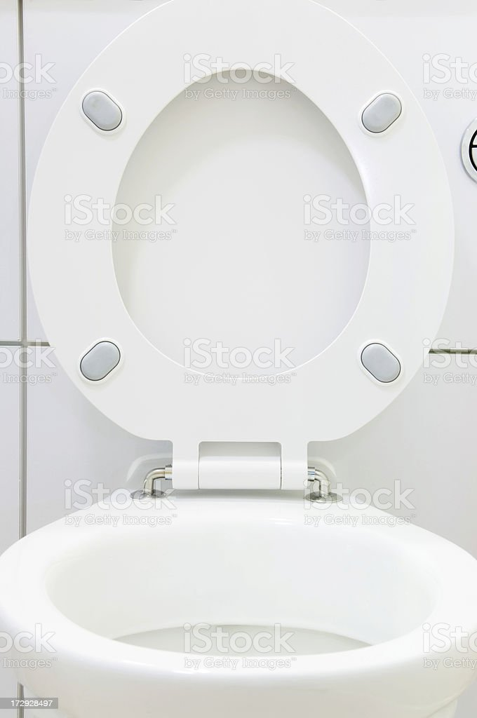 Close up of white porcelain toilet with seat up stock photo