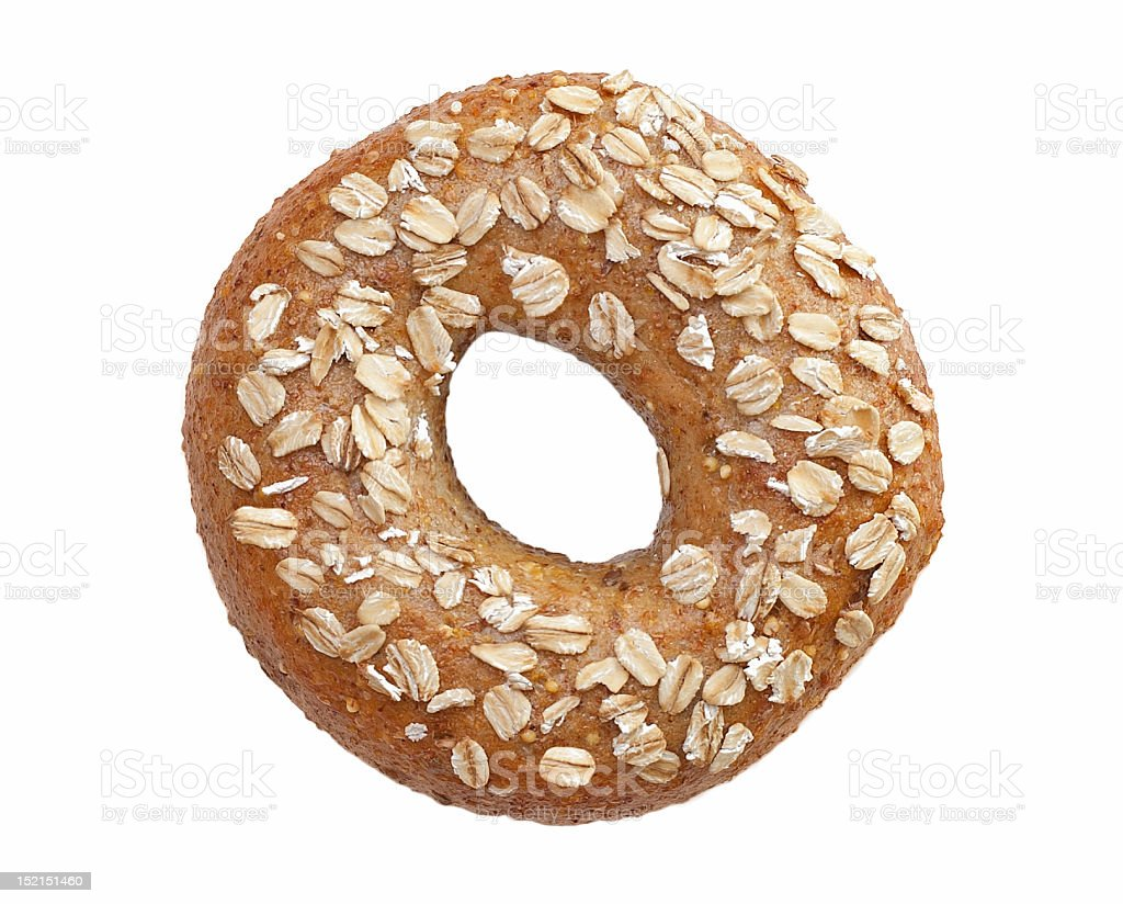 Close up of wholemeal bagel with seeds on top royalty-free stock photo