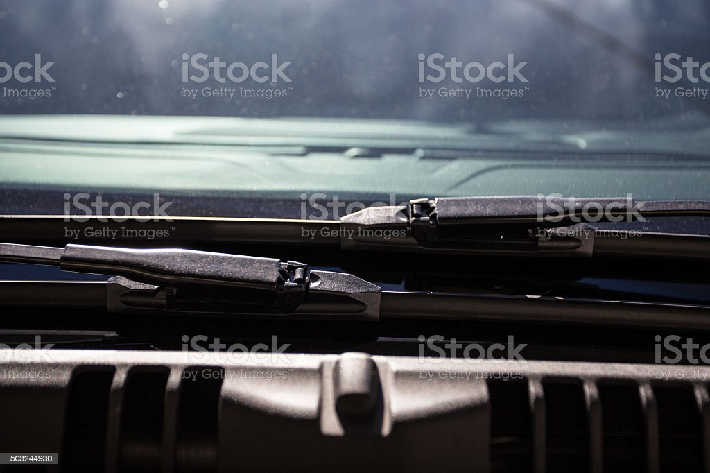 close up of wiper blades and windshield stock photo
