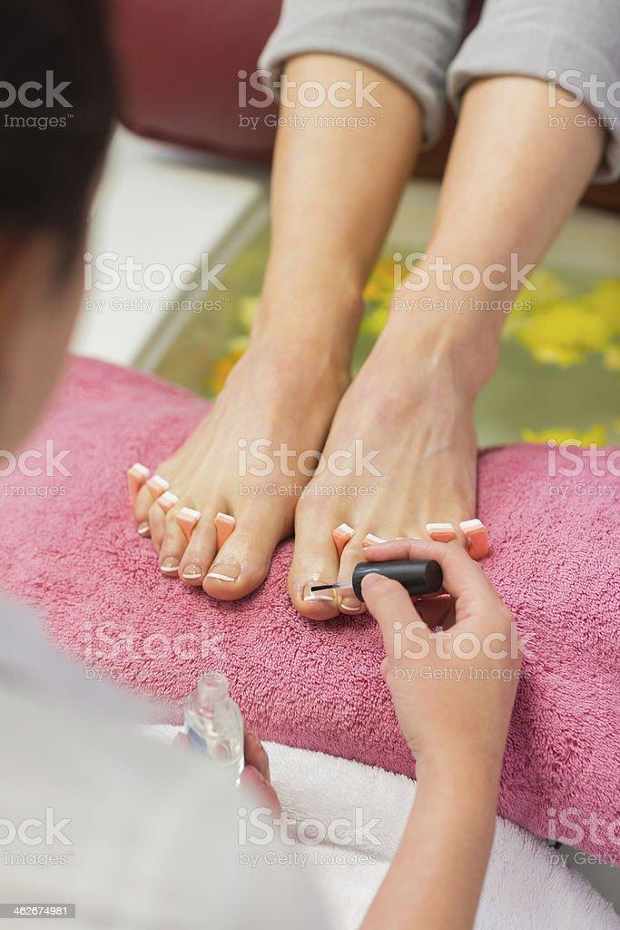 Close up of woman applying nail varnish stock photo