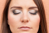 Close up of woman face with make up.