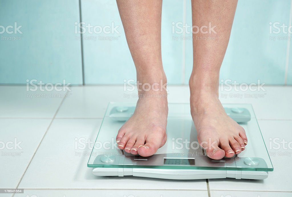 close up of woman feet weighing in bathroom royalty-free stock photo