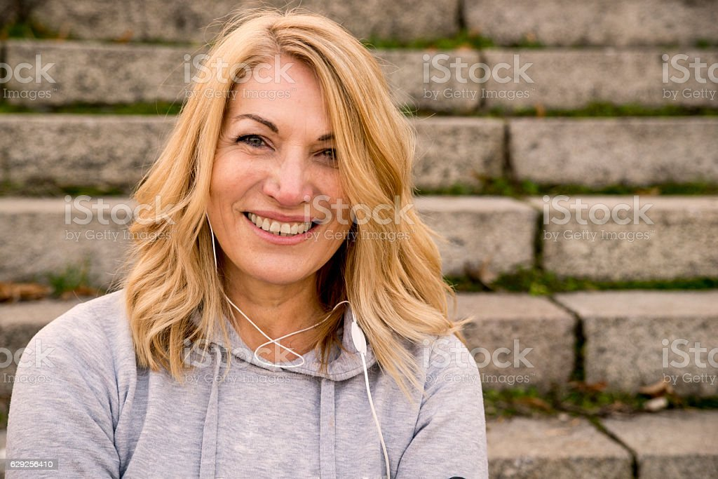 Close up of woman fitness mature woman resting stock photo