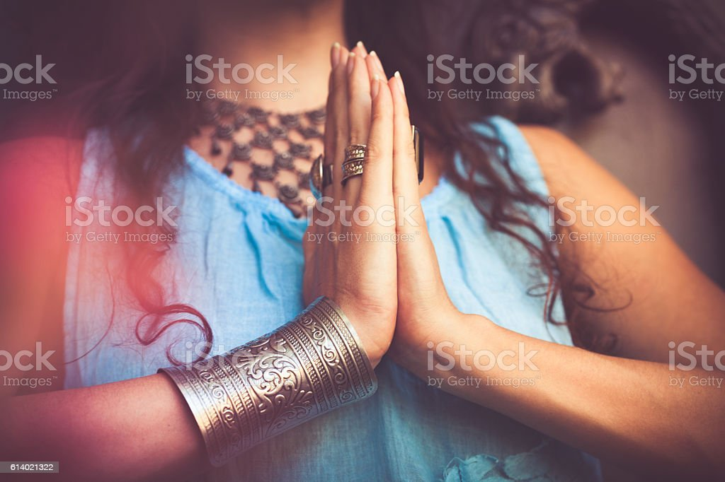 close up of woman hands in namaste gesture stock photo
