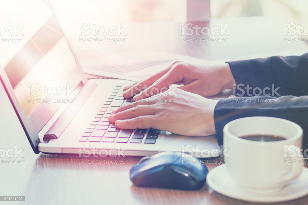 Close Up of woman hands using laptop stock photo