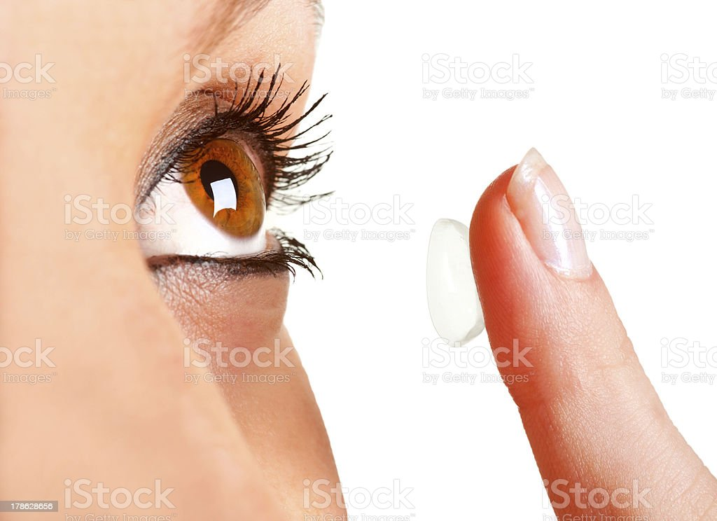 Close up of woman holding contact lens royalty-free stock photo
