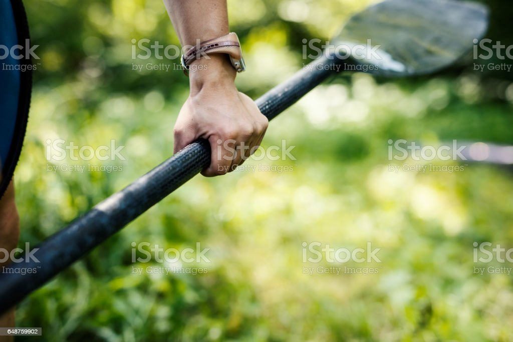 Close up of woman holding kayaking paddle stock photo