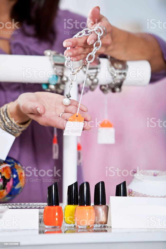Close up of woman holding price tag in boutique stock photo