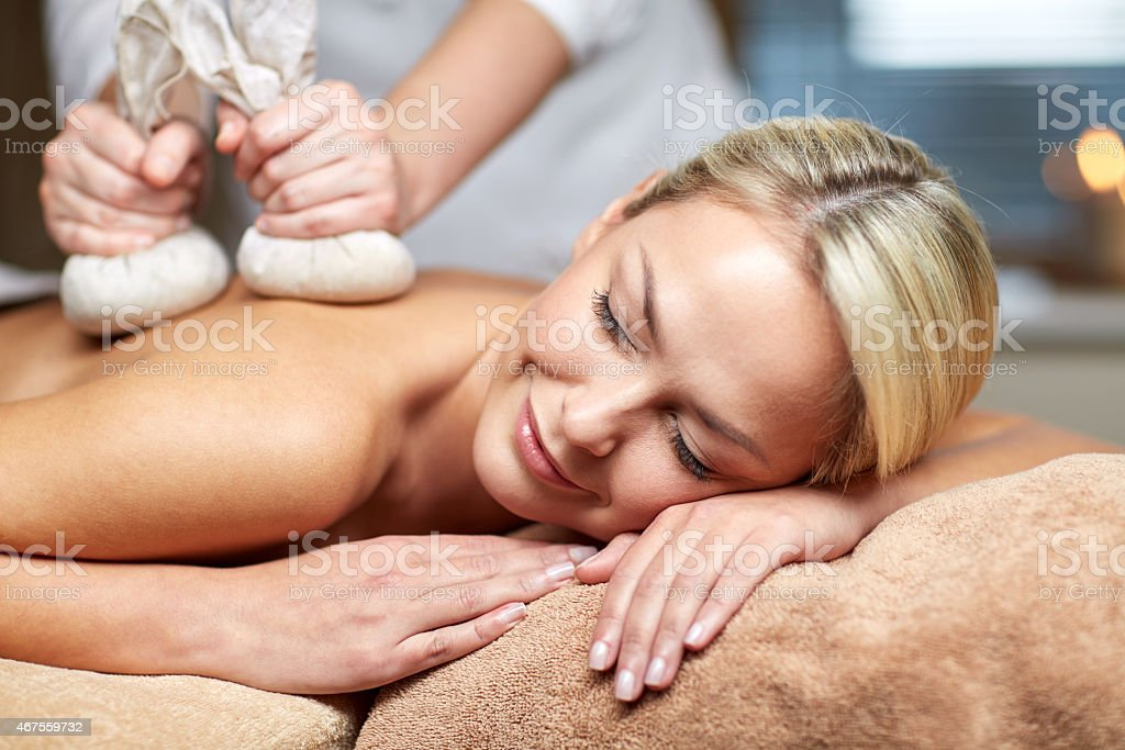 close up of woman lying on massage table in spa stock photo