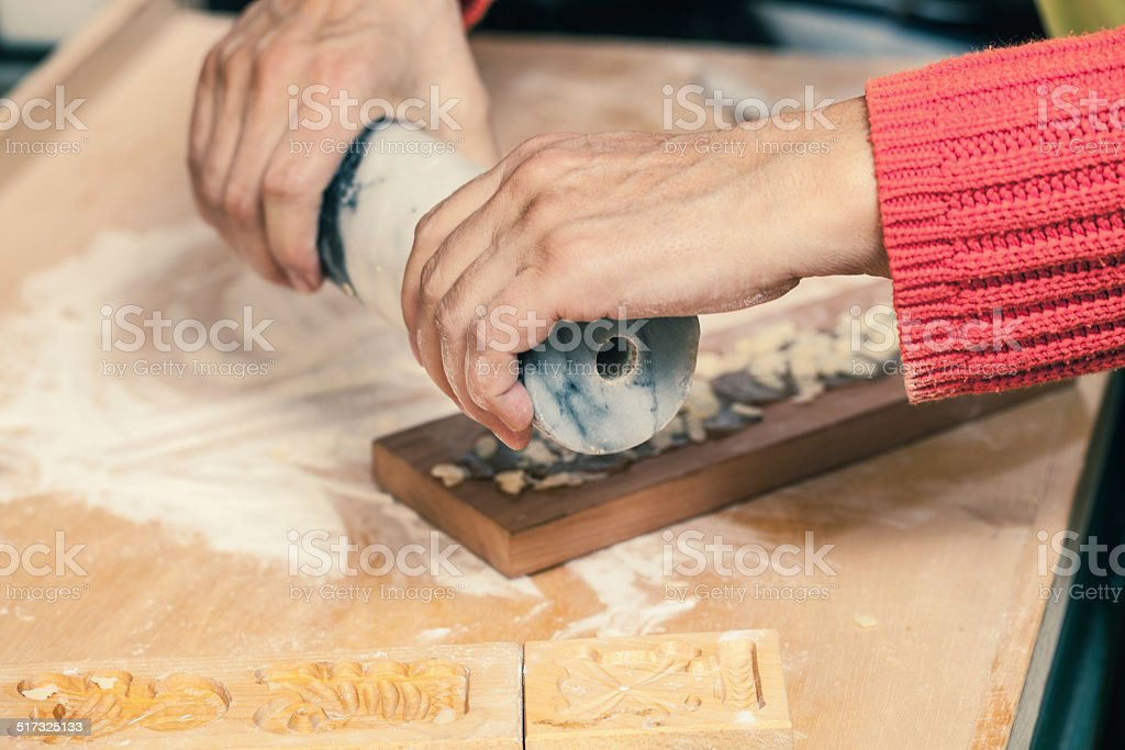 Close up of woman making christmas cookies stock photo