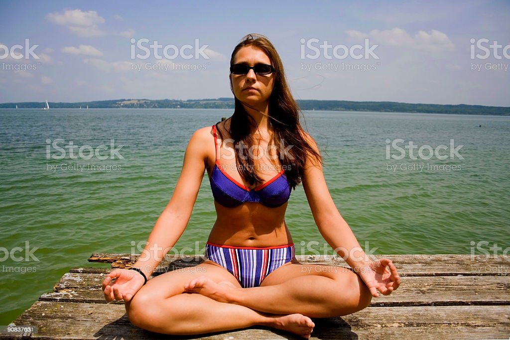 close up of woman meditating royalty-free stock photo