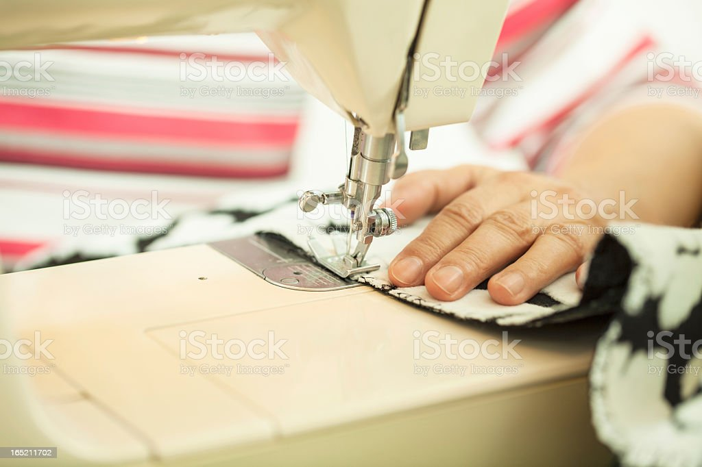 Close up of woman sewing on sewing machine royalty-free stock photo