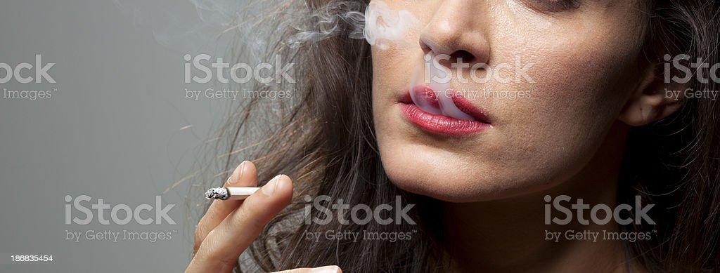 Close up of woman smoking. stock photo