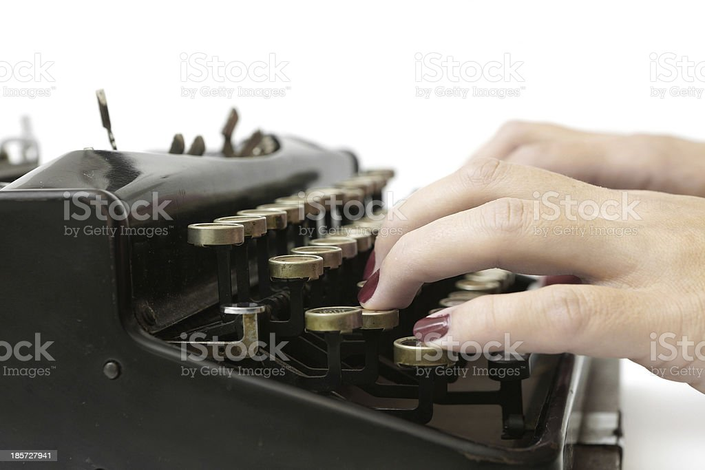 close up of woman typing with old typewriter royalty-free stock photo
