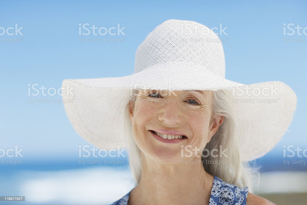 Close up of woman wearing sun hat royalty-free stock photo